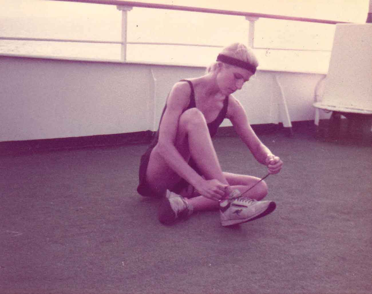 "ALT =[""Dr. Jolie Bookspan: Dr. Bookspan pioneered putting fitness on cruise ships in the early 1980s.""Pictured here getting ready to teach Parcours (Parkour, Free Running) starting with a run on the ships rails.]"