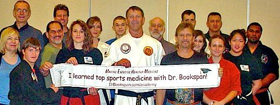 "ALT =[""Black Belts Learned Better Training with Dr. Jolie Bookspan: Students of Dr. Bookspan's Black Belt Hall of Fame 2011 seminar on the Top 10 Injury Prevention Techniques.""]"