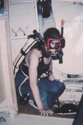 "ALT =[""Dr. Jolie Bookspan: Dr. Bookspan getting ready to leave the hatch of the underwater lab for data collection outside""]"