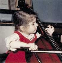 "ALT =[""Dr. Jolie Bookspan at age 2 and a half playing the cello: More on Dr. Bookspan's bio web page - http://drbookspan.com/bio]"